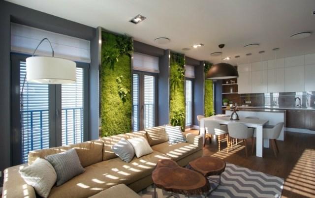 decoration-salon-murs-végétalisés-canapé-beige-clair-coussins-gris-beige-tapis-gris-chevron décoration de salon