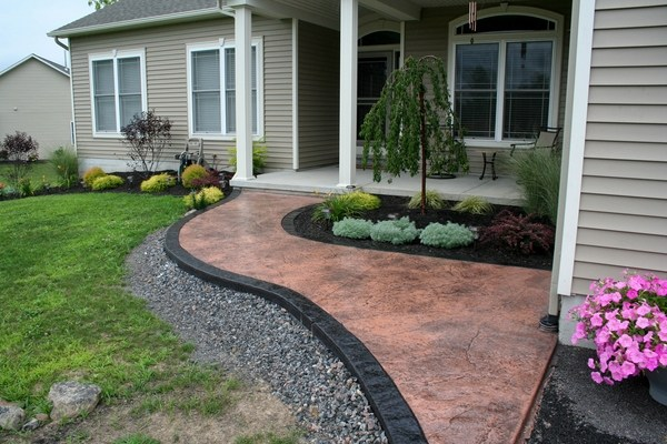 Stamped concrete adds depth and beauty to the exterior on Patio And Path Ideas  id=87112