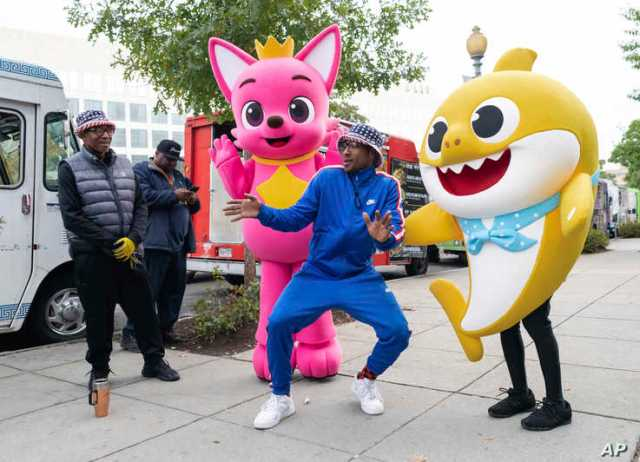 Pinkfong and Baby Shark cheer on the Washington Nationals with fans of all ages ahead of Game 3 of the World Series, while gifting WowWee's official Baby Shark toys at various landmarks in Washington.
