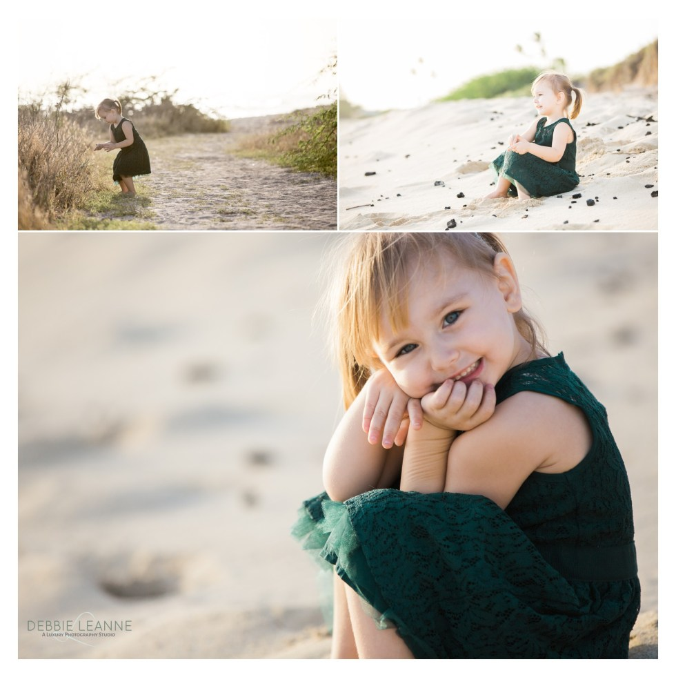 little girl in green dress at the beach