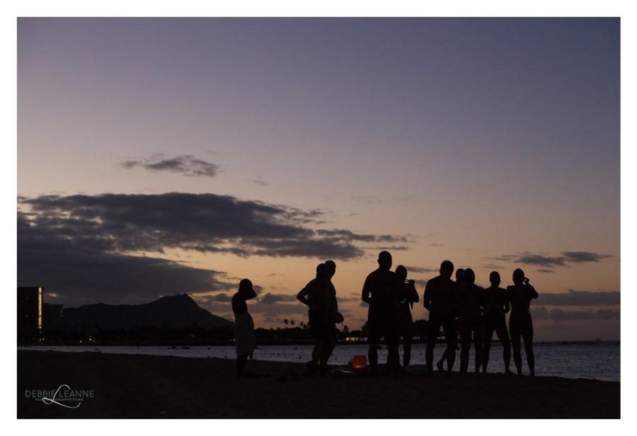 sunrise over ala Moana with silhouette of people