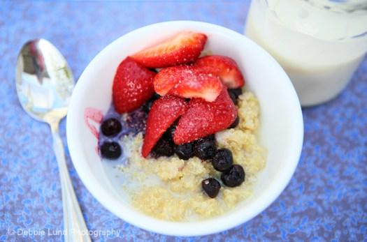 healthy breakfast of quinoa, fruit and kefir