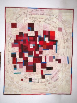 "GOD SPEAKS. Another departure from the Housetop style. It started with just a little stitching doodle, in a spiral shape. So much of God's creation involves spirals--have you noticed? And then I thought about all the places that God has spoken from in the Bible--and that was the basis for this quilt. Machine quilted with words hand embroidered. 42""X33"" $375.00"