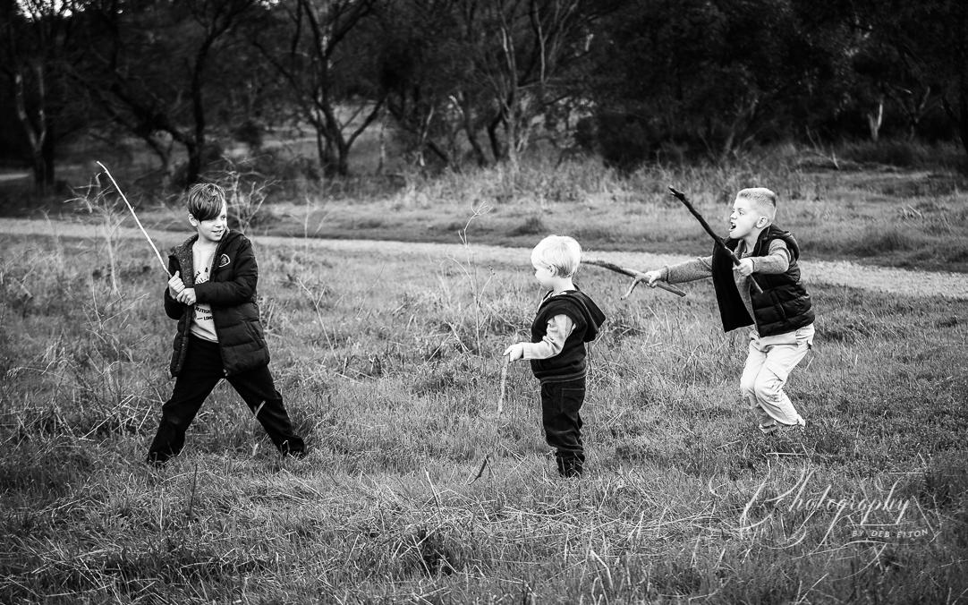 boys+playing+field+sticks