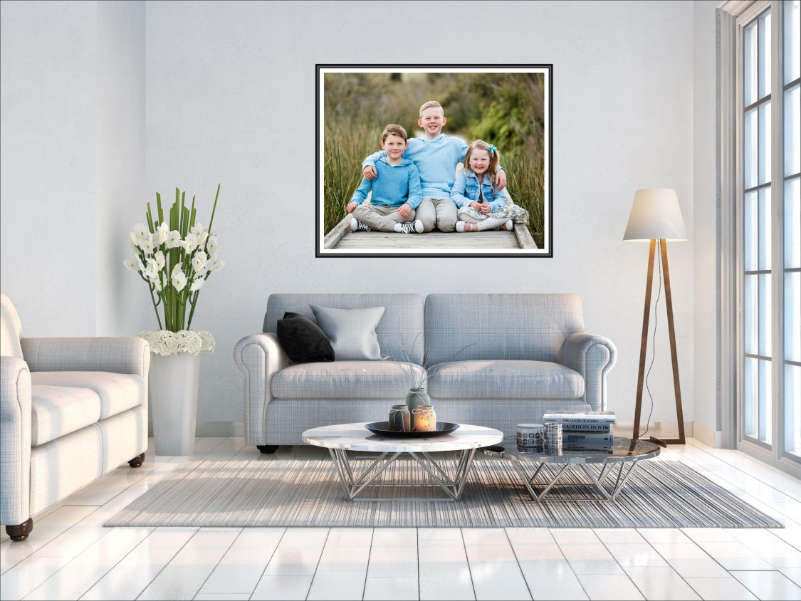 large framed famil  picture on the wall