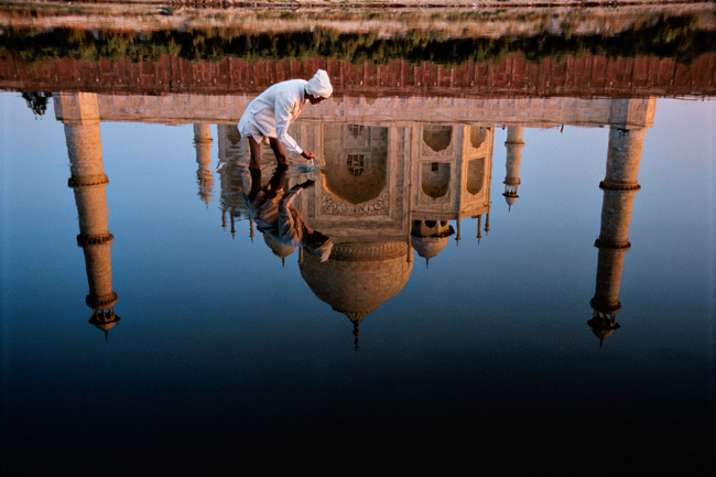 Reflection in the Yamuna River of the Taj Mahal, completed in 1638 by the Mughal emperor Shah Jahan after the 1629 death of his favorite wife, Mumtaz Mahal. Agra, India, 1999.