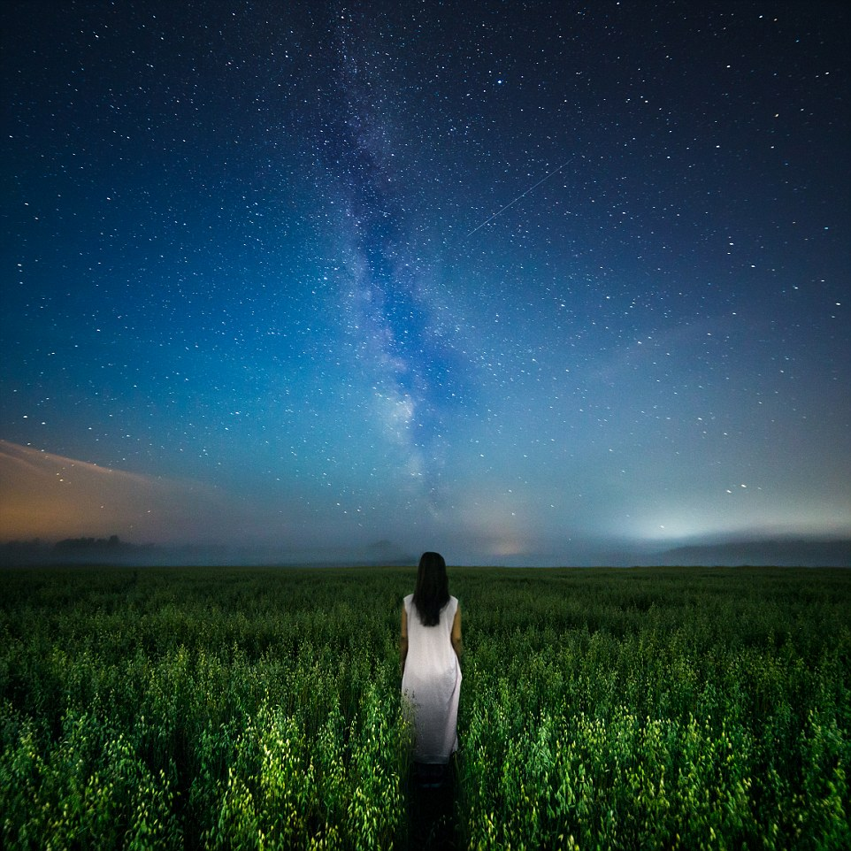 """I wanted to capture this long exposure image right in the middle of a dark night with the Milky Way showing. The image shows a woman walking along a path, a path which seems to lead up to the Milky Way. She may be heading to her physical home for now, but eventually we all return to our stellar origins as starstuff. My goal was to capture a portrait that displays not just the physical aspects of a person, but a portrait of her whole being as a part of a larger universe."""