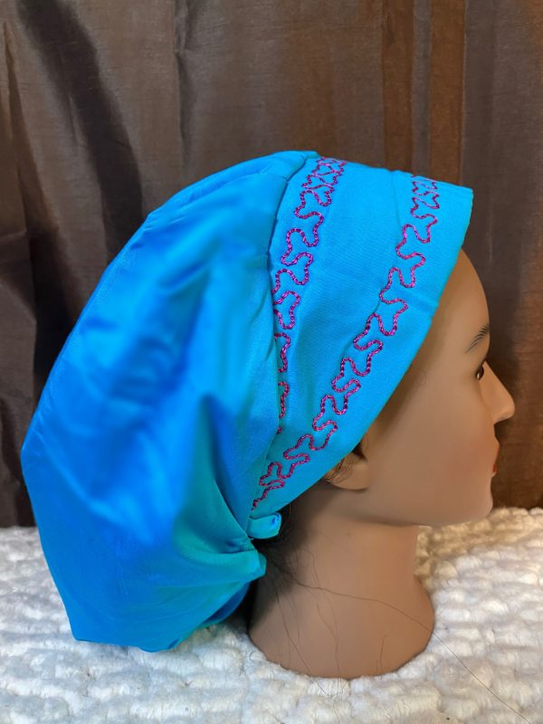 blue bouffant scrub hat with pink embroidery