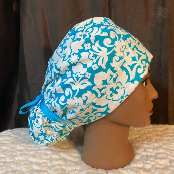 blue and white flower scrub hat