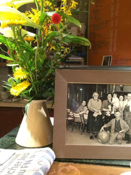 Photo of flowers and family photo at a neighborhood café