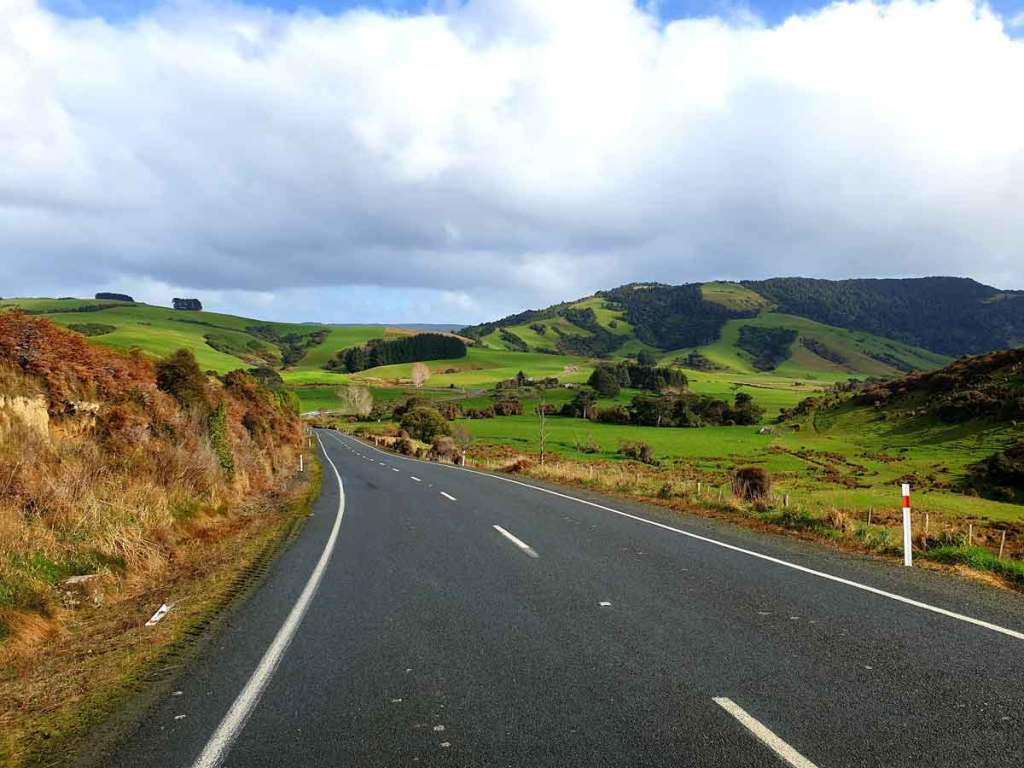 New Zealand, open road through the countryside