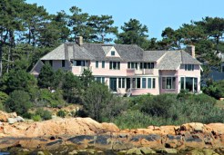 Pink house on the shore