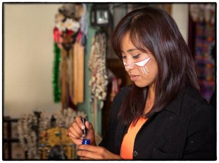 Diana Molina applies facepaint