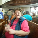 Smiling woman sitting in church.