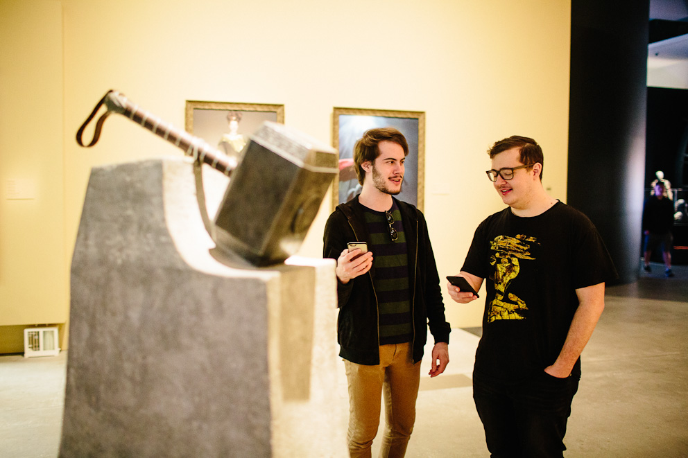 Ryan and Wade at the Mjölnir display learning about its lore with the Marvel Mobile AR at GOMA 2017
