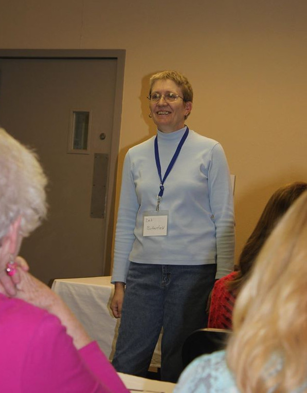 Editor Debra L. Butterfield teaching at a writers conference.