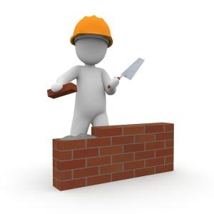 little man building brick wall