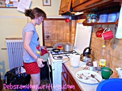 My daughter getting used to handling a hot pancake pan....