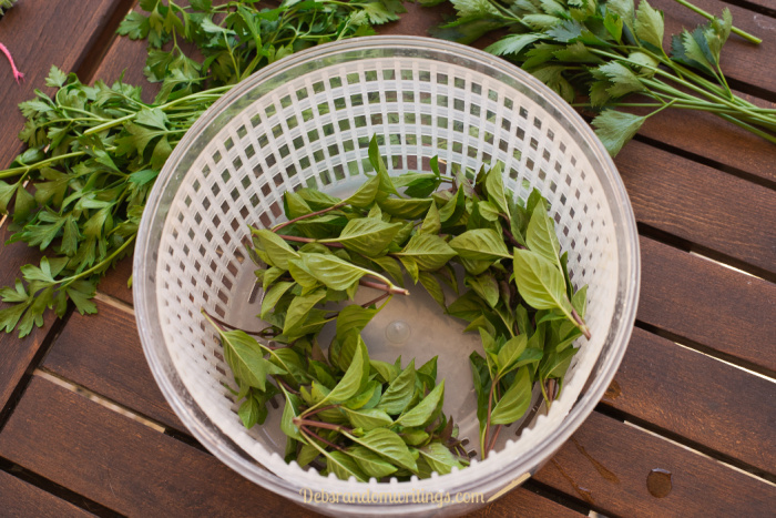 A salad spinner is a handy tool to use to dry fresh herbs after washing.