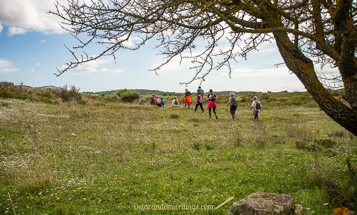 Hikers crossing a field.