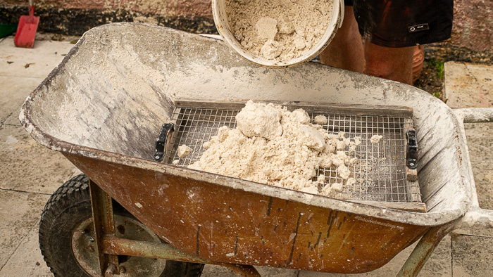 Cement being saved into a wheel barrow.