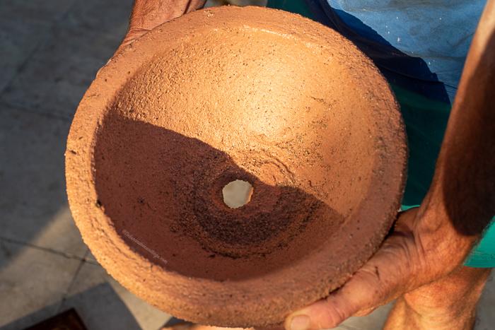 A homemade concrete flower pot