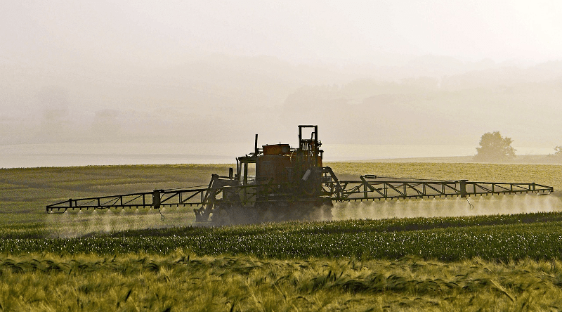 Tractor spraying pesticides