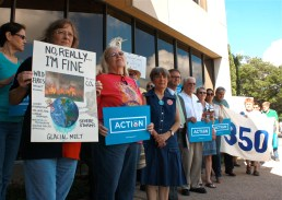 About two dozen protestors gathered outside U.S. Rep. Smith's offices today before delivering his award.