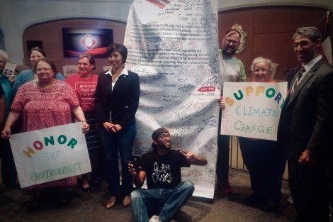 Nirenberg and Sandoval w/ climate action banner