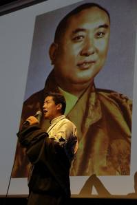 Palden sings a song in praise of the Tenth Panchen Lama