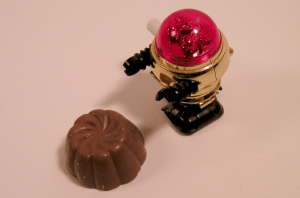 toy robot eating a chocolate