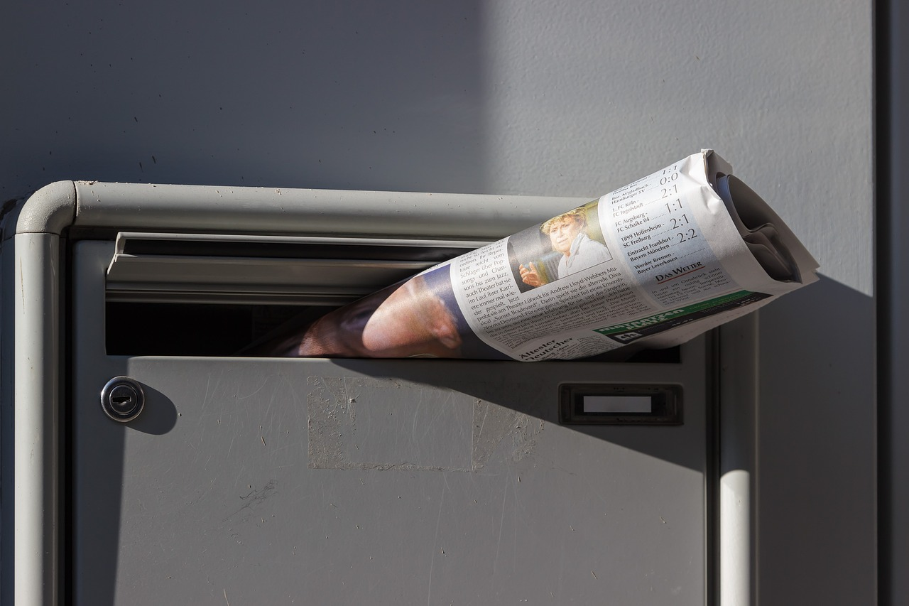 newspaper in mailbox