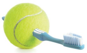 FIGURE 2. A patient's toothbrush can be inserted into a small slit cut into the side of a tennis ball to improve his or her ability to grip it.