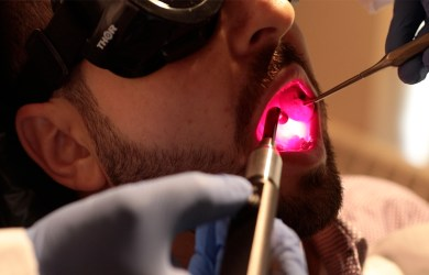 Light therapy for oral mucositis