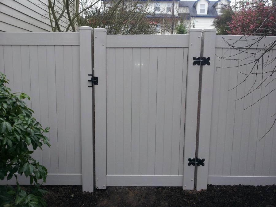 Grey PVC fence and gates Deck Masters LLC