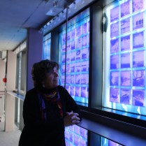 Artist Sarah Hall looks up at her work from inside the Enwave Theare