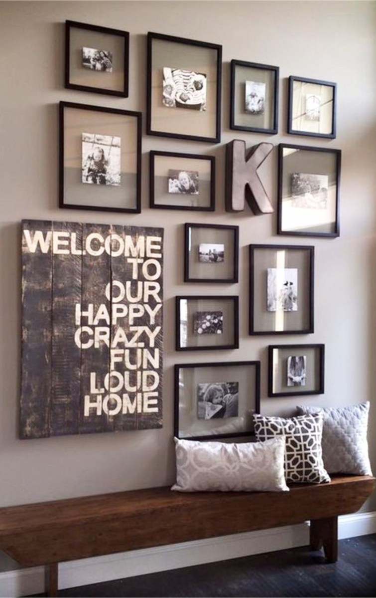 Using all the same frames on your gallery wall can give it a neat and organized look.  LOVE that rustic / pallet bench too!  Gallery wall ideas for your foyer #gallerywallideas #decoratingideas #livingroomideas #diyhomedecor #homedecorideas