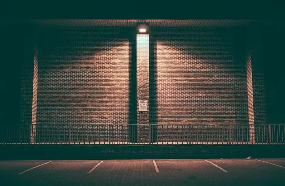 A brick wall, dimly lit at night