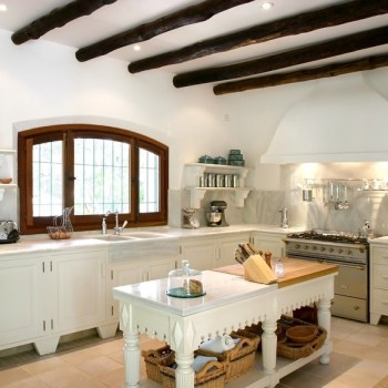 Kitchen interior of large spanish villa. With wooden rafters on