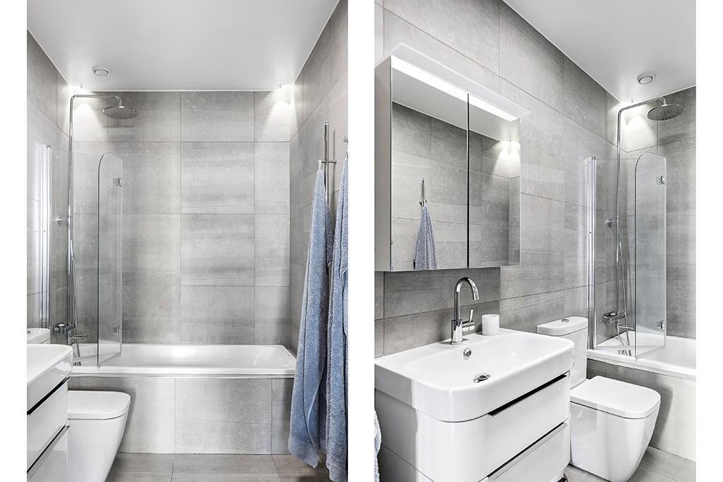 ванная комната ванна серая плитка раковина комод зеркало