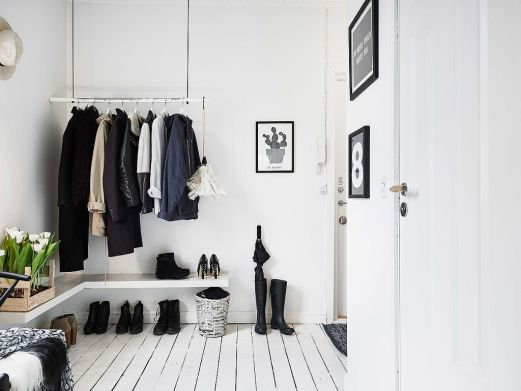 7. DIY wooden coat rack. Note: you can use the boots as an umbrella stand.