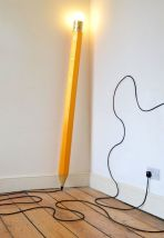 An oversize pencil lamp