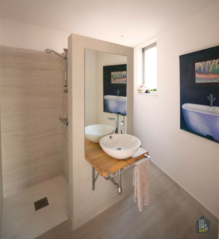 Espacios independientes en un baño mínimo