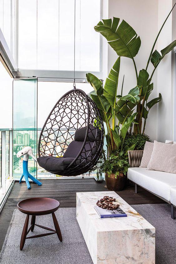 decoralinks | terraza con doble altura cerrada con cortinas de cristal