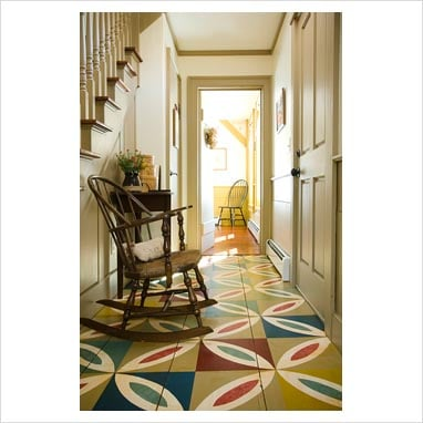Hallway in colonial home with colorful wooden floor