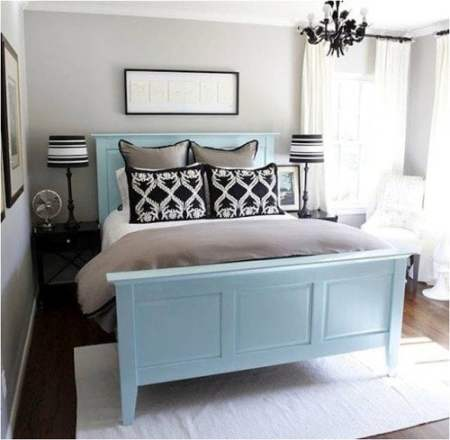 pale blue bed with black and taupe accents