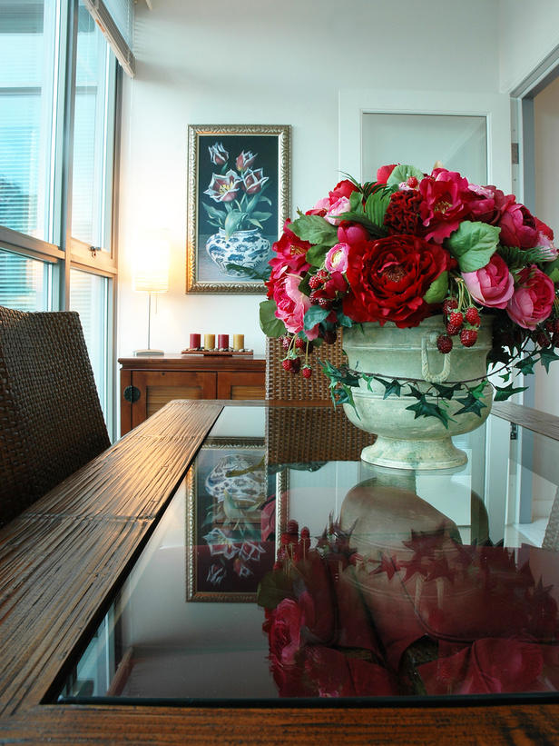 Dining Room With Rose Floral Centerpiece On A Glass Table
