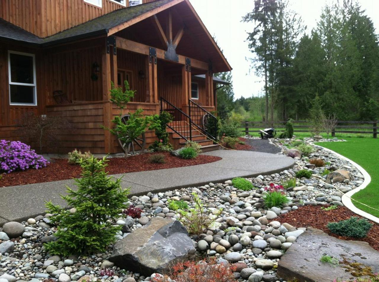 Front Yard Landscaping Ideas with White Rocks 27
