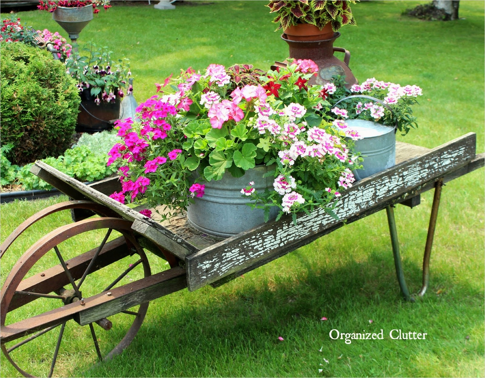 44 Amazing Rustic Garden Ideas 22 Rustic Garden Wheelbarrow 2015 9