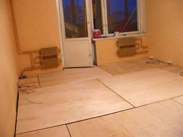 how to lay tiles on wooden floor is it
